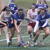 Chelmsford vs Methuen girls lacrosse. From left, Chelmsford's Jamie Wild (11), Methuen's Hannah McDonald (22), Chelmsford's Maya Dube (7) and Methuen's Rosemary Mahoney (13). (SUN/Julia Malakie)