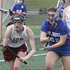Chelmsford vs Methuen girls lacrosse. Chelmsford's Jamie Wild (11) and Methuen's Hannah McDonald (22). (SUN/Julia Malakie)