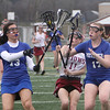 Chelmsford vs Methuen girls lacrosse. Chelmsford's Jamie Wild (11) and Methuen's Rosemary Mahoney (13) and Hannah McKenna (17).  (SUN/Julia Malakie)