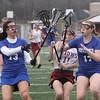 Chelmsford vs Methuen girls lacrosse. Chelmsford's Jamie Wild (11) and Methuen's Rosemary Mahoney (13) and Hannah McKenna (17).  (SUN/Julia Malakie)