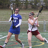Chelmsford vs Methuen girls lacrosse. Methuen's Rosemary Mahoney (13) and Chelmsford's Lilly King (20).  (SUN/Julia Malakie)