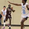 Dracut vs Chelmsford boys basketball. Chelmsford's Suubi Nkugba (5), passing, and Dracut's Adrian Torres (11) and Nathan Boateng (10). (SUN/Julia Malakie)