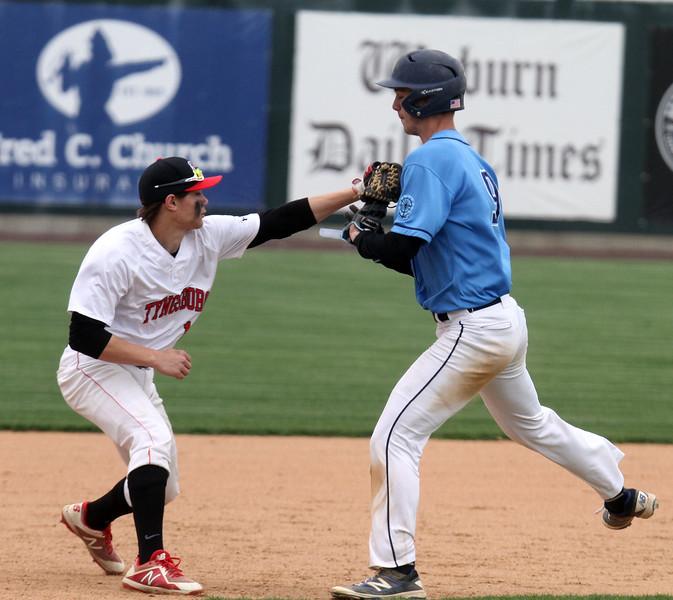 Dracut vs Tyngsboro baseball. Dracut's Daniel Robichaud (9) is tagged out by Tyngsboro third baseman John Shaffer in a rundown in the top of the fourth inning. (SUN/Julia Malakie)