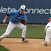 Dracut vs Tyngsboro baseball. Tyngsboro's Chris Ausiello (9) is safe at second with a stolen base, Dracut second baseman Jack Leahy (13) fielding in the bottom of the third inning. (SUN/Julia Malakie)