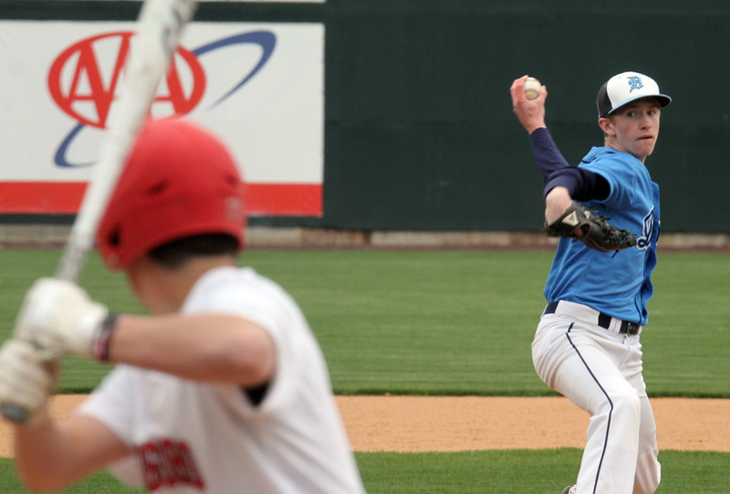 Dracut vs Tyngsboro baseball. Dracut's Sean McMeniman (19) pitches to Tyngsboro's Phil Sutherland in the bottom of the second inning.(SUN/Julia Malakie)
