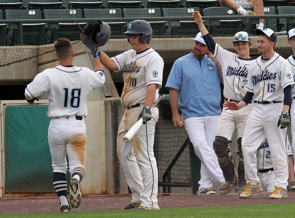 . Dracut vs Tyngsboro baseball in Mickey Sullivan Classic. Dracut\'s Ryan Talbot (18) is greeted at the dugout by Christopher Nugent (10) after scoring in the bottom of the third inning. (SUN/Julia Malakie)