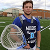 Dracut lacrosse goalie, senior Calvin Desmarais, 18, at practice. JULIA MALAKIE/LOWELLSUN