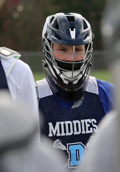 Dracut lacrosse goalie, senior Calvin Desmarais, 18, at practice. JULIA MALAKIE/LOWELLSUN