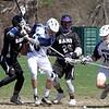 Dracut vs Shawsheen Tech boys lacrosse. Shawsheen Tech's Peter Canniff (2) and Dave Fraser (26), and Dracut's Aaron Hines (16) and ---- Honan/Horan? (15). (SUN/Julia Malakie)