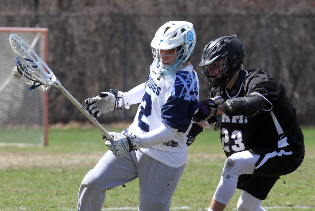 . Dracut vs Shawsheen Tech boys lacrosse. Dracut\'s Alvin Demarus (2) and Shawsheen Tech\'s Dylan Timmons (23).  (SUN/Julia Malakie)
