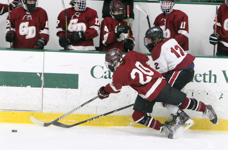 Fitchburg/Monty Tech vs Groton-Dunstable boys hockey. Groton-Dunstable's Nate Glencross (20) and Fitchburg/Monty Tech's Max Beaulac (12). (SUN/Julia Malakie)