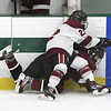 Fitchburg/Monty Tech vs Groton-Dunstable boys hockey. Fitchburg/Monty Tech's Sam Jaramillo (22), top, and Groton-Dunstable's Ryan Bushnell (12). (SUN/Julia Malakie)