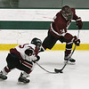 Fitchburg/Monty Tech vs Groton-Dunstable boys hockey. Fitchburg/Monty Tech's Riley Leblanc (23) and Groton-Dunstable's Jacob Figueroa (14).  (SUN/Julia Malakie)