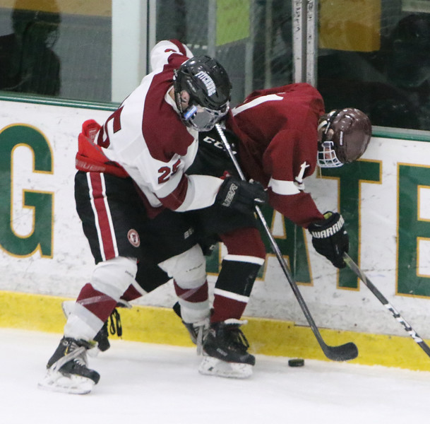 Fitchburg/Monty Tech vs Groton-Dunstable boys hockey. Fitchburg/Monty Tech's Zac Robillard (25) and Groton-Dunstable's Dylan Cianci (11). (SUN/Julia Malakie)