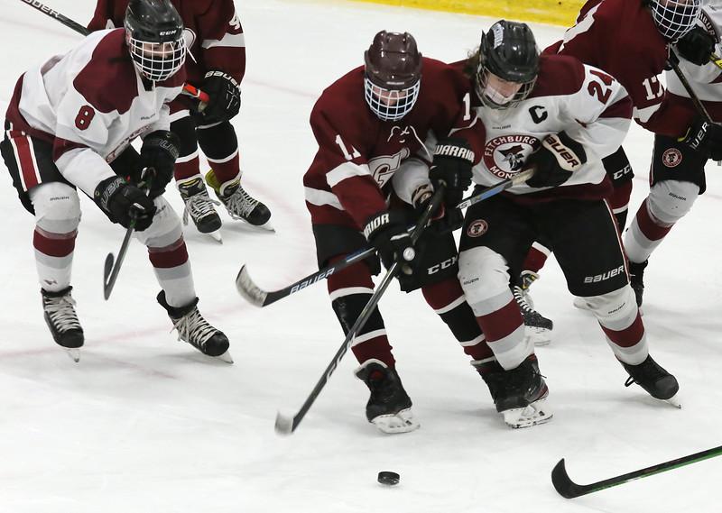 Fitchburg/Monty Tech vs Groton-Dunstable boys hockey. Groton-Dunstable's Dylan Cianci (11) and Fitchburg/Monty Tech's Peter Stephens (24) and Cooper Hall (8). (SUN/Julia Malakie)