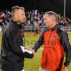 Coaches meet at mid field after game - Quarrles 200th win.