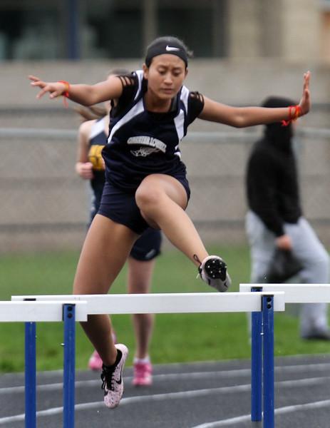 Greater Lowell, Notre Dame Academy & Northeast Tech track meet. Greater Lowell's Elizabeth Phan in 400M Hurdles. (SUN/Julia Malakie)