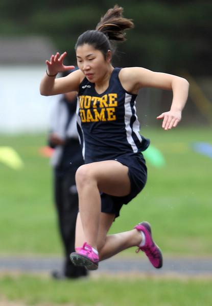 Greater Lowell, Notre Dame Academy & Northeast Tech track meet. NDA's Rose Strobel in Long Jump.  (SUN/Julia Malakie)