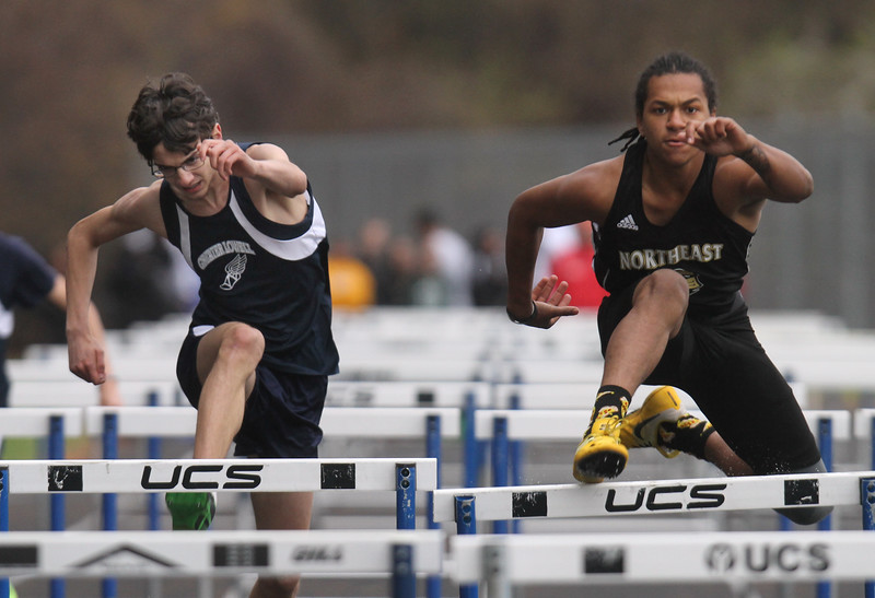 Greater Lowell, Notre Dame Academy & Northeast Tech track meet. Greater Lowell's Joseph Troche, left, and Northeast Tech's Tyrese Jones in boys 100M Hurdles. (SUN/Julia Malakie)