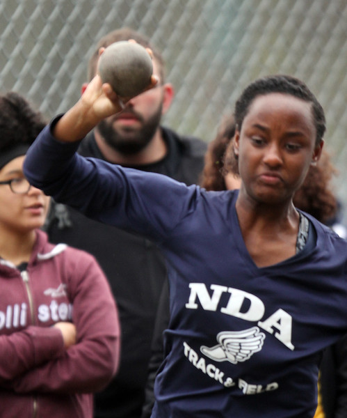 Greater Lowell, Notre Dame Academy & Northeast Tech track meet. NDA's Ashley Tovar in Shot Put.  (SUN/Julia Malakie)