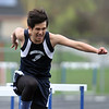 Greater Lowell, Notre Dame Academy & Northeast Tech track meet. Greater Lowell's Andrew Kim in 400M Hurdles. (SUN/Julia Malakie)