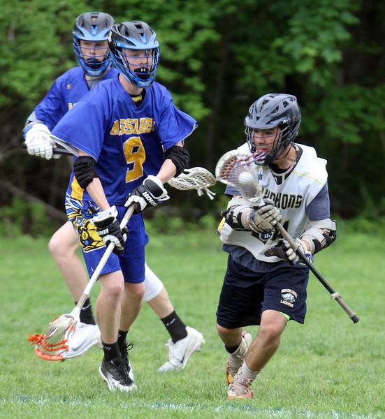 Greater Lowell Tech vs Assabet Valley boys lacrosse. Assabet's Mike Blasko (9) and Greater Lowell's Kyle Proulx (24).  (SUN/Julia Malakie)
