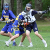 Greater Lowell Tech vs Assabet Valley boys lacrosse. From left, Assabet's Justin DuPont (90) and Brendan Drobinski (36), and Greater Lowell's Justin Finch (27).  (SUN/Julia Malakie)