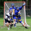 Greater Lowell Tech vs Assabet Valley boys lacrosse. Greater Lowell's Justin Finch (27) and Assabet's Nero Bono (0) and goalie Jonathan Crutchfield (45). (SUN/Julia Malakie)