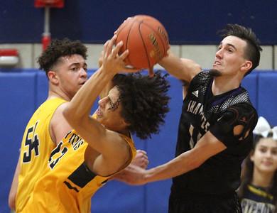 Greater Lowell vs Shawsheen Tech boys basketball. Greater Lowell's Josh Ortiz (54) and Paul Chote (23), and Shawsheen's Ryan Quinones (11). (SUN/Julia Malakie)