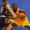 Greater Lowell Tech vs Greater Lawrence Tech boys basketball. Greater Lawrence's Rene Mota (15) and Greater Lowell's Ian Kirumira (22). (SUN/Julia Malakie)