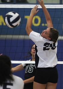 Greater Lowell Tech vs Lowell Catholic girls volleyball. Lowell Catholic's Sveva Riccardi (15) and Greater Lowell's Madelyn Kearns (20). (SUN/Julia Malakie)