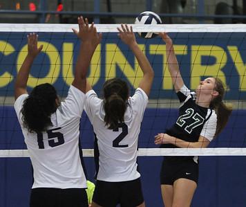 Greater Lowell Tech vs Lowell Catholic girls volleyball. Greater Lowell's Araceli Lopez (15), Jessica Chin (2) and Lowell Catholic's Haley Lowell (27). (SUN/Julia Malakie)