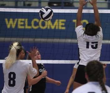 Greater Lowell Tech vs Lowell Catholic girls volleyball. Greater Lowell's Rachel Rinaldi (8) and Araceli Lopez (15), and Lowell Catholic's Victoria Buttaglia (20). (SUN/Julia Malakie)