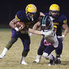 Greater Lowell Tech vs Lowell Catholic football.  Greater Lowell's Benji Hach (5), left, and Monetry Vilavong (53), and Lowell Catholic's Aidan Maston (9). (SUN/Julia Malakie)