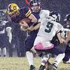 Greater Lowell Tech vs Lowell Catholic football. Greater Lowell QB Jacob Trzcienski (4), is tackled by Lowell Catholic's Aidan Maston (9). (SUN/Julia Malakie)