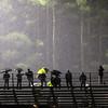 Spectators in the rain at Greater Lowell Tech vs Lowell Catholic football.  (SUN/Julia Malakie)