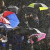 Crowd in rain at Greater Lowell Tech vs Lowell Catholic football.  (SUN/Julia Malakie)