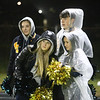 Greater Lowell Tech vs Lowell Catholic football. Greater Lowell cheerleaders from left, Rylee Parrington, Cate Nickerson, Jon Dailey and Maddy Faria, in rain gear. (SUN/Julia Malakie)