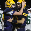 Greater Lowell Tech vs Lowell Catholic football. Greater Lowell's David Mallahan (66), left, hugs Kyle Proulx (12) after Proulx's TD gave Greater Lowell a 20-0 lead.  (SUN/Julia Malakie)
