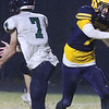 Greater Lowell Tech vs Lowell Catholic football.  Lowell Catholic's Danny McConologue, left, knocks down a pass intended for Greater Lowell's Nik Zeoli, right. (SUN/Julia Malakie)