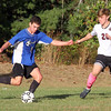 Groton-Dunstable vs Bromfield Academy boys soccer. Bromfield's Reilly Fitzsimmons (4) and Groton-Dunstable's Ian Maguire (20). (SUN/Julia Malakie)