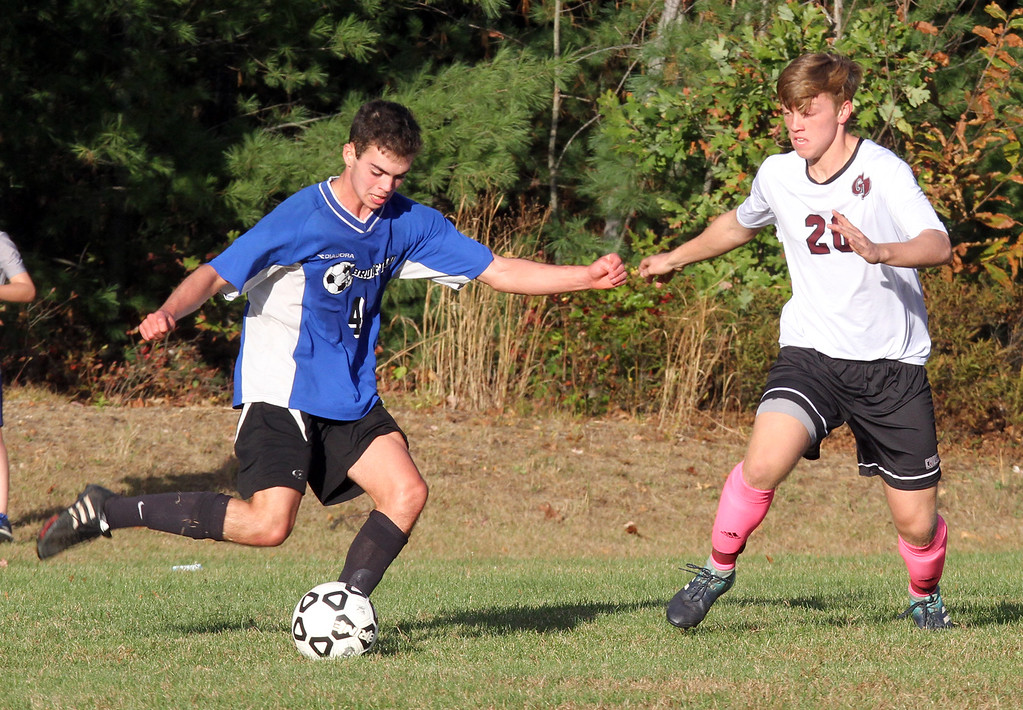 . Groton-Dunstable vs Bromfield Academy boys soccer. Bromfield\'s Reilly Fitzsimmons (4) and Groton-Dunstable\'s Ian Maguire (20). (SUN/Julia Malakie)