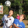 Groton-Dunstable vs Bromfield Academy boys soccer. Groton-Dunstable's Junjae (Peter) Ho (16) and Bromfield's Jack Armstrong (7). (SUN/Julia Malakie)