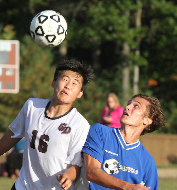 . Groton-Dunstable vs Bromfield Academy boys soccer. Groton-Dunstable\'s Junjae (Peter) Ho (16) and Bromfield\'s Jack Armstrong (7). (SUN/Julia Malakie)