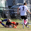 Groton-Dunstable vs Bromfield Academy boys soccer. Bromfield goalkeeper Austin Franklin stops a shot by Groton-Dunstable's Will Zinkann (7). (SUN/Julia Malakie)