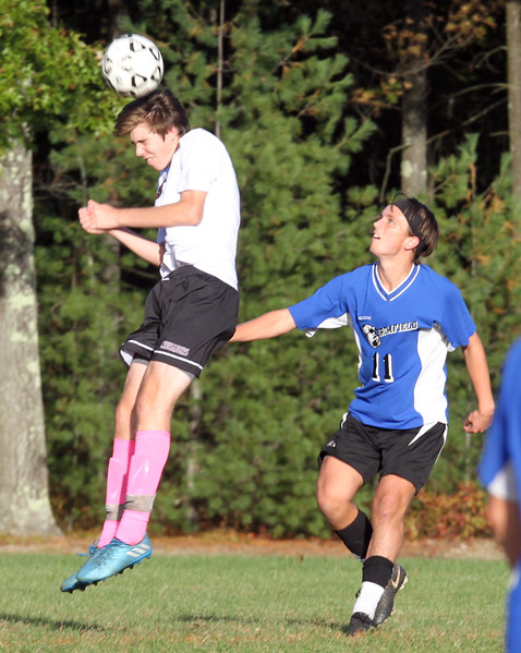 Groton-Dunstable vs Bromfield Academy boys soccer. Groton-Dunstable's Jamuel Enke (6) and Bromfield's Shane Bilodeau (11). (SUN/Julia Malakie)