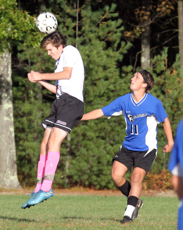 . Groton-Dunstable vs Bromfield Academy boys soccer. Groton-Dunstable\'s Jamuel Enke (6) and Bromfield\'s Shane Bilodeau (11). (SUN/Julia Malakie)