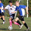Groton-Dunstable vs Bromfield Academy boys soccer. Groton-Dunstable's Junjae (Peter) Ho (16) and Bromfield's Ryell Derjviter (2). (SUN/Julia Malakie)