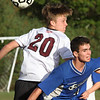 Groton-Dunstable vs Bromfield Academy boys soccer. Groton-Dunstable's Ian Maguire (20) and Bromfield's Reilly Fitzsimmons (4). (SUN/Julia Malakie)