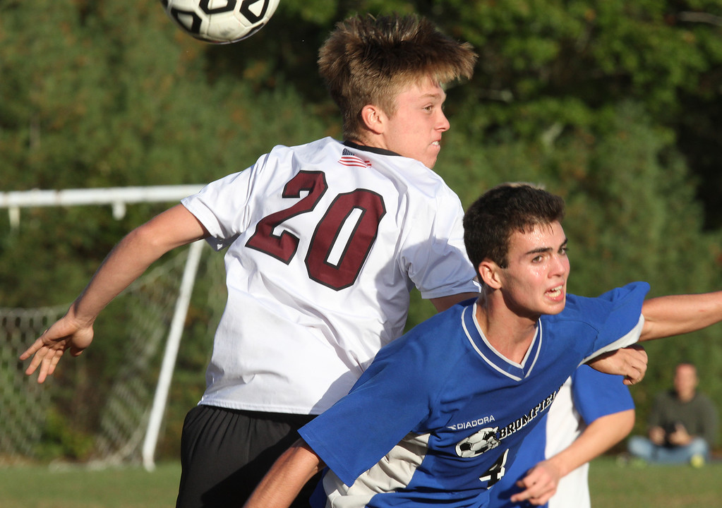 . Groton-Dunstable vs Bromfield Academy boys soccer. Groton-Dunstable\'s Ian Maguire (20) and Bromfield\'s Reilly Fitzsimmons (4). (SUN/Julia Malakie)